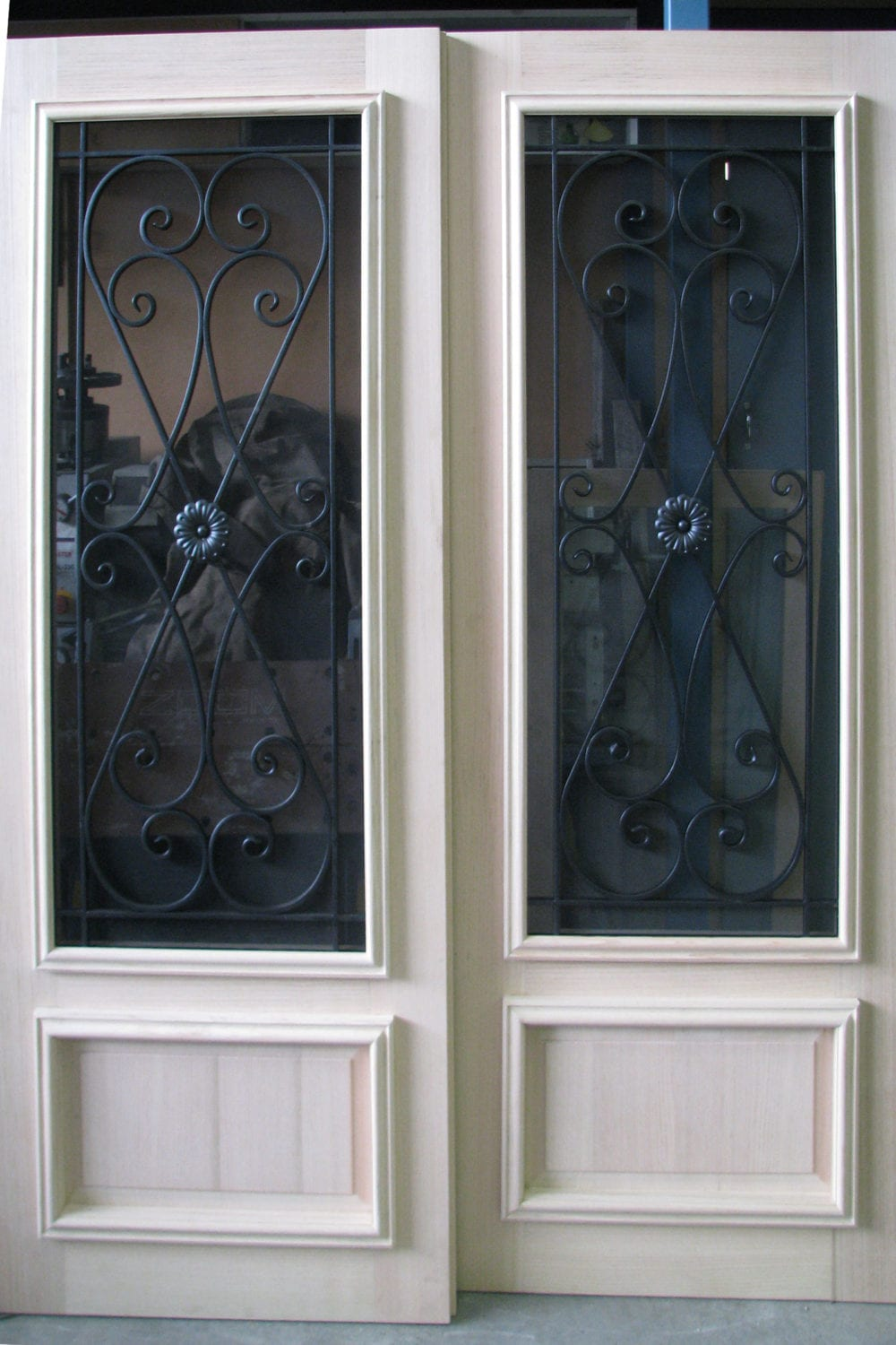 timber wrought iron doors add beauty elegance security